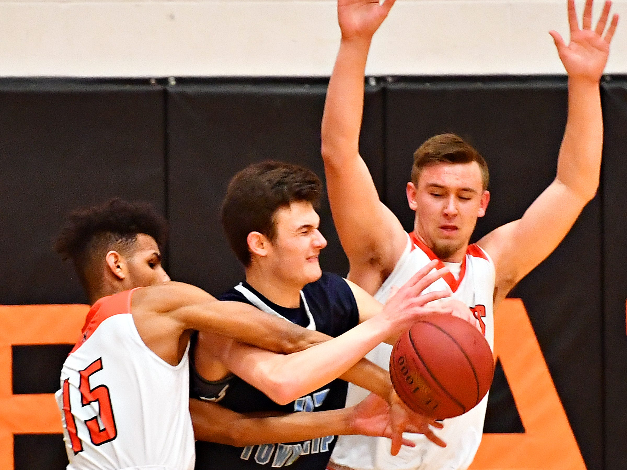 Manheim Township's Tyler Vicidomini, center, can't get past Northeastern's Nick Rizzuto, left, and Zech Sanderson during basketball action at Northeastern Senior High School in Manchester, Wednesday, Jan. 9, 2019. Northeastern would win the game 47-46. Dawn J. Sagert photo