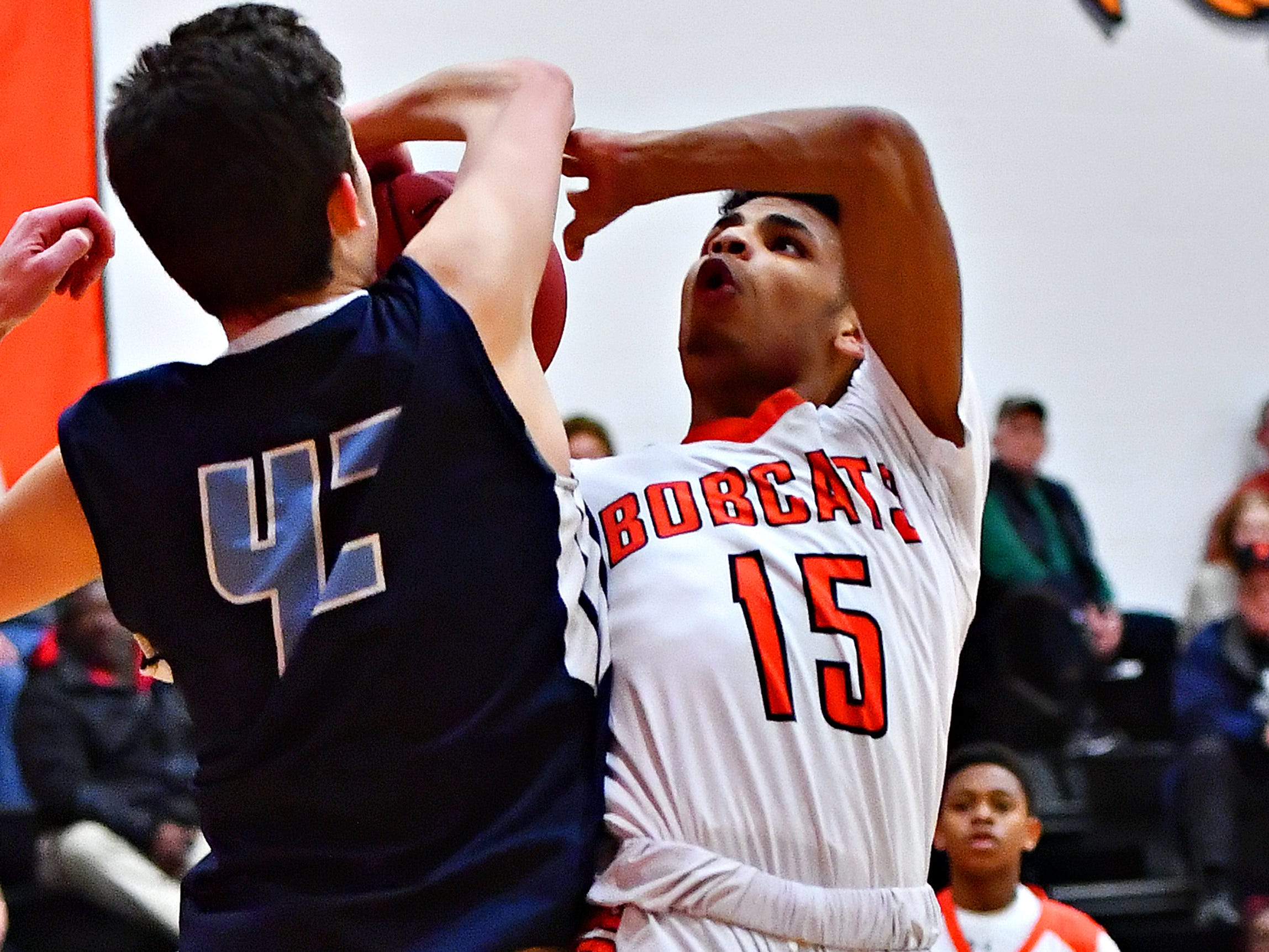 Northeastern's Maurice Capo, right, is fouled by Manheim Township's Tyler Vicidomini during basketball action at Northeastern Senior High School in Manchester, Wednesday, Jan. 9, 2019. Northeastern would win the game 47-46. Dawn J. Sagert photo
