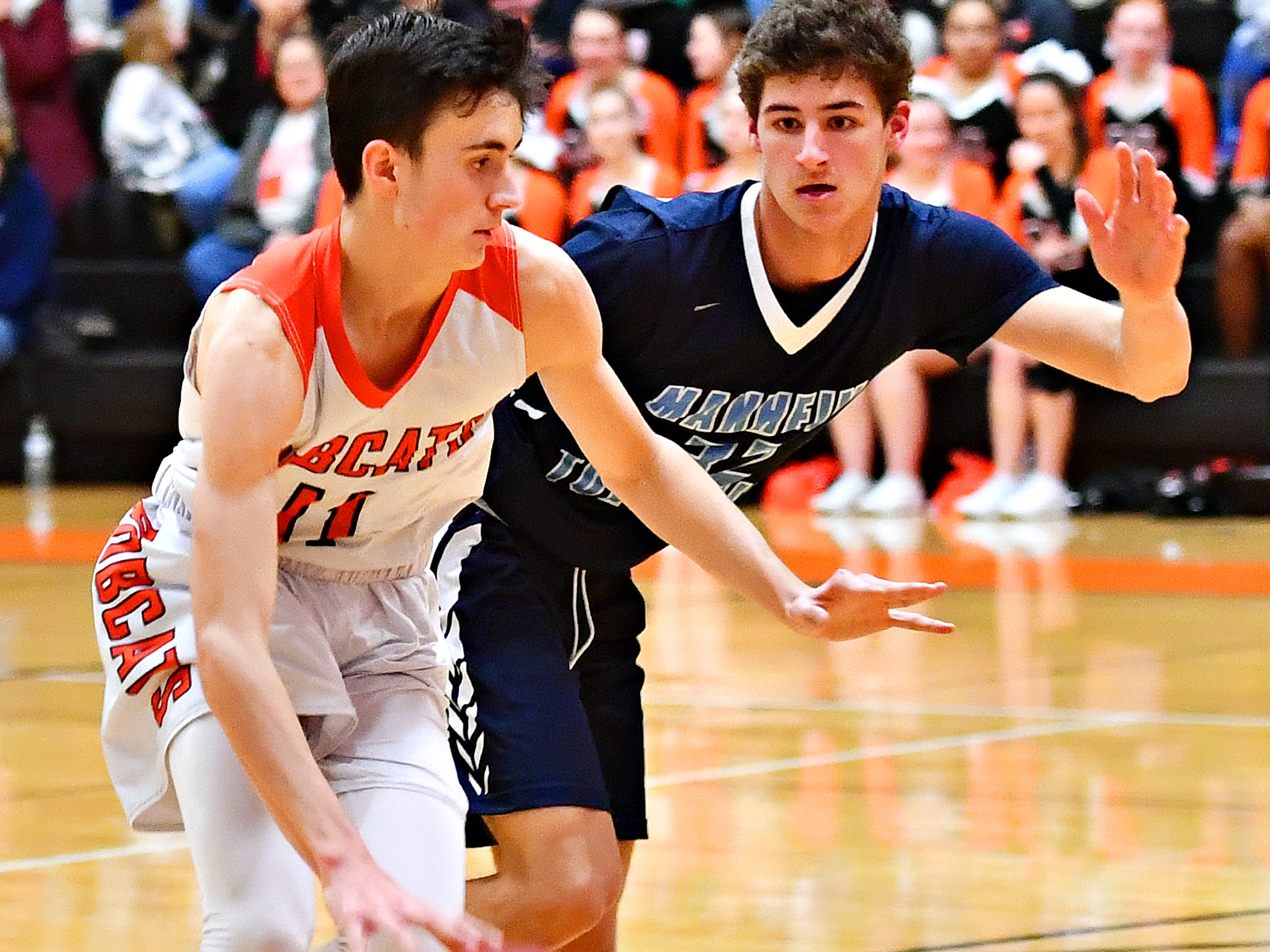 Northeastern's Andrew Brodbeck, left, works to get around Manheim Township's Colin Yablonski during basketball action at Northeastern Senior High School in Manchester, Wednesday, Jan. 9, 2019. Northeastern would win the game 47-46. Dawn J. Sagert photo