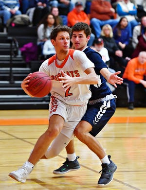 Northeastern's Nate Wilson, shown here driving on the baseline, scored 16 points and made the game-winning 3-pointer against Manheim Township at Northeastern Senior High School in Manchester, Wednesday, Jan. 9, 2019. Dawn J. Sagert photo