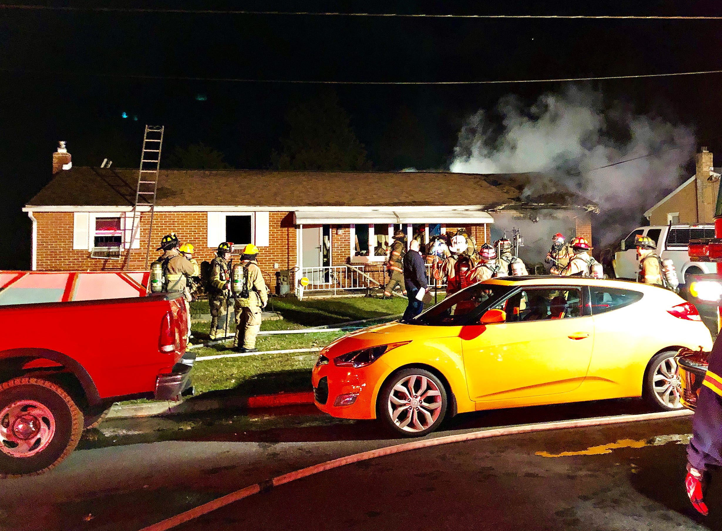 Firefighters work a structure fire on Teslin Road in Manchester Township, Wednesday, Jan. 9, 2019. Dawn J. Sagert photo