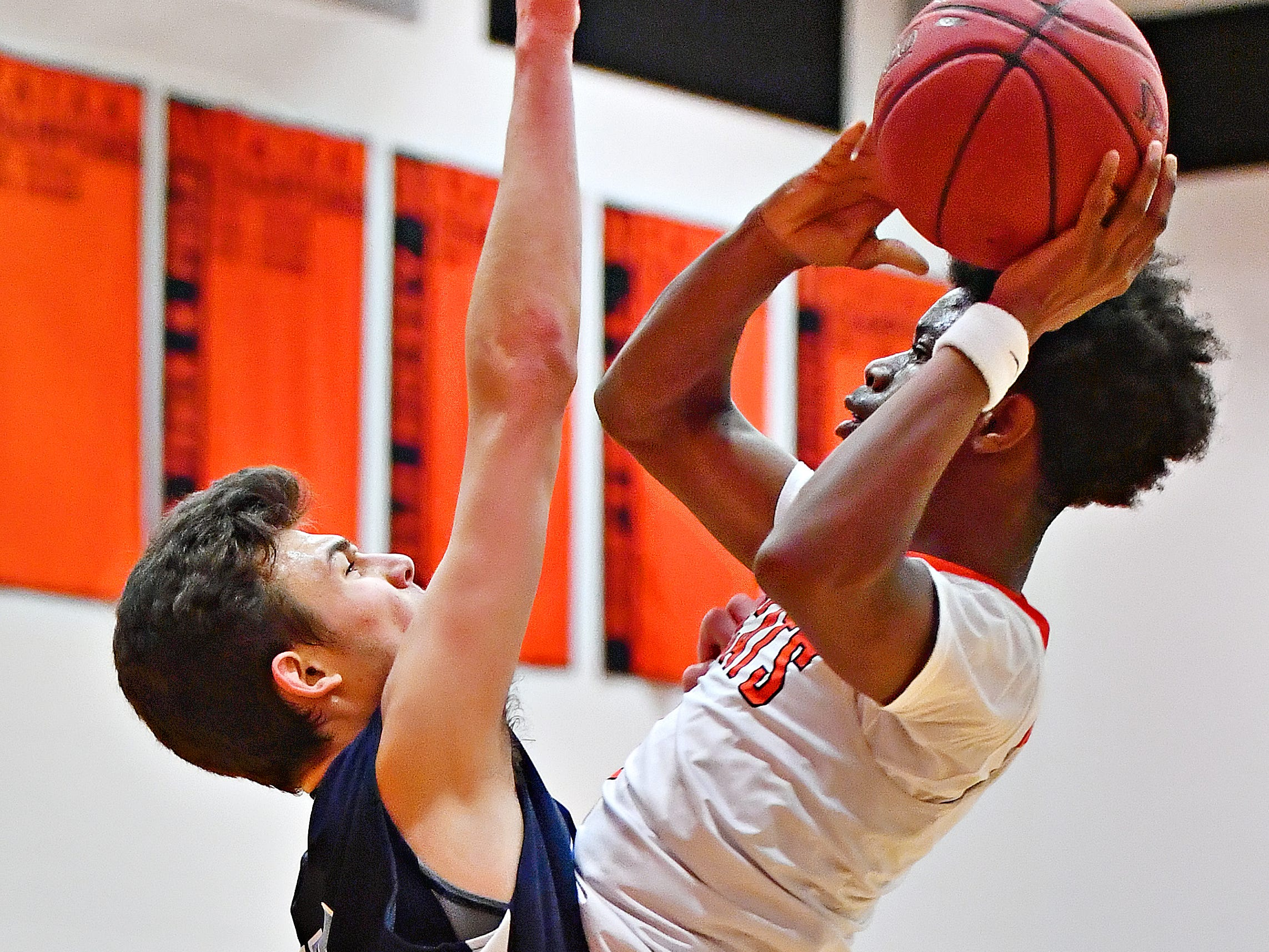 Manheim Township's Tyler Vicidomini, left, stops Northeastern's Quay Mulbah at the basket during basketball action at Northeastern Senior High School in Manchester, Wednesday, Jan. 9, 2019. Northeastern would win the game 47-46. Dawn J. Sagert photo