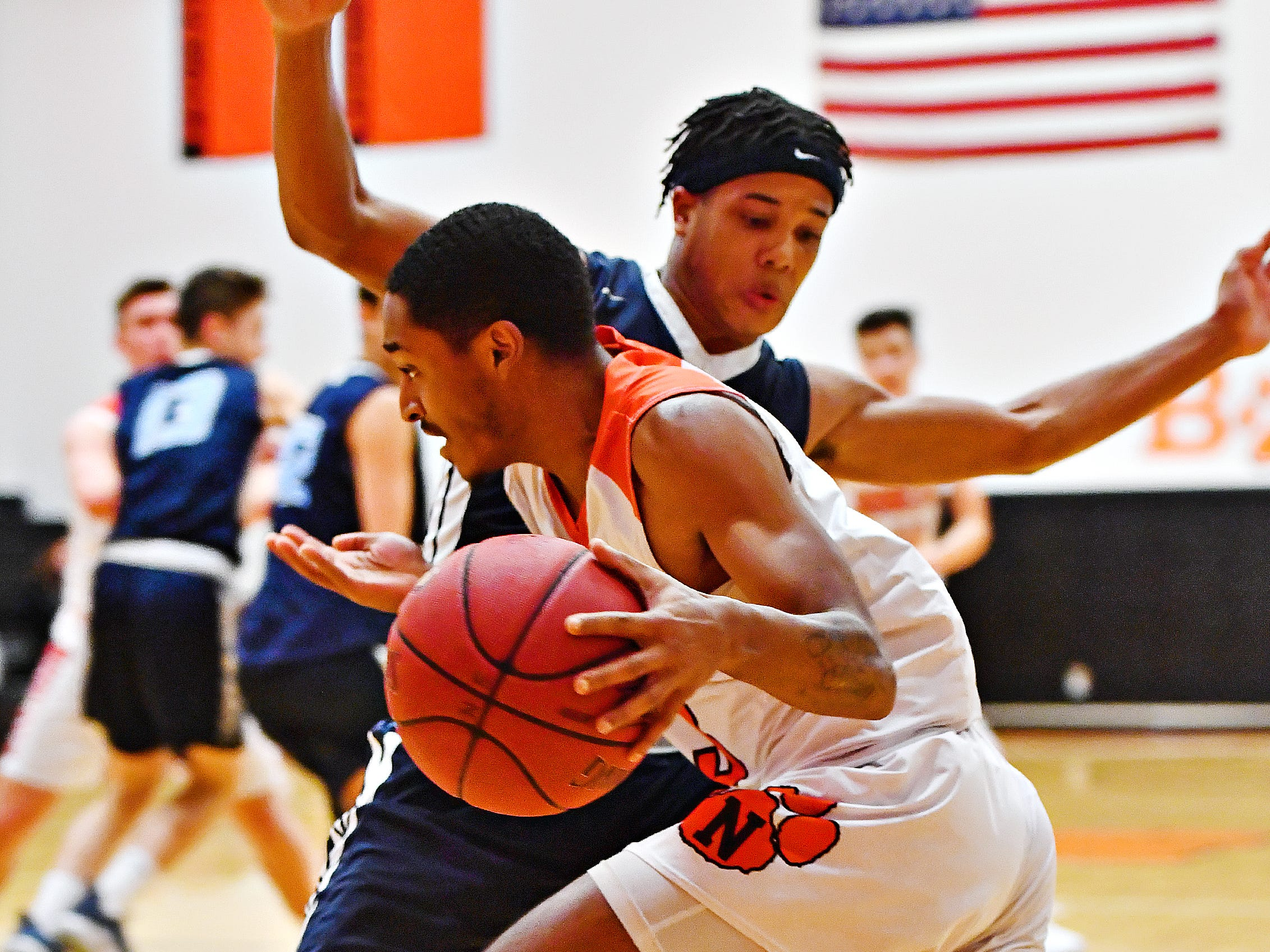 Northeastern's Devyn Baltimore, front, looks to get past Manheim Township's Kyle Musser during basketball action at Northeastern Senior High School in Manchester, Wednesday, Jan. 9, 2019. Northeastern would win the game 47-46. Dawn J. Sagert photo