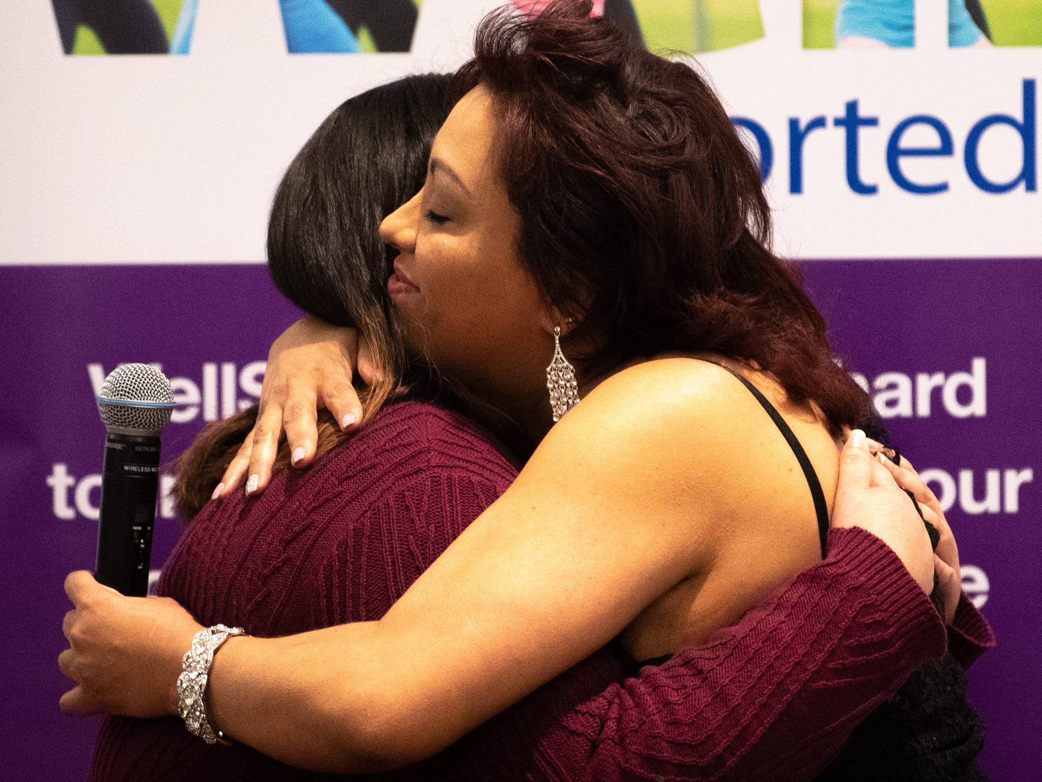 Paola Almonte (left) hugs the award presenter during the 2019 City of York Human Relations Commission Diversity Dinner at York College, January 9, 2019.