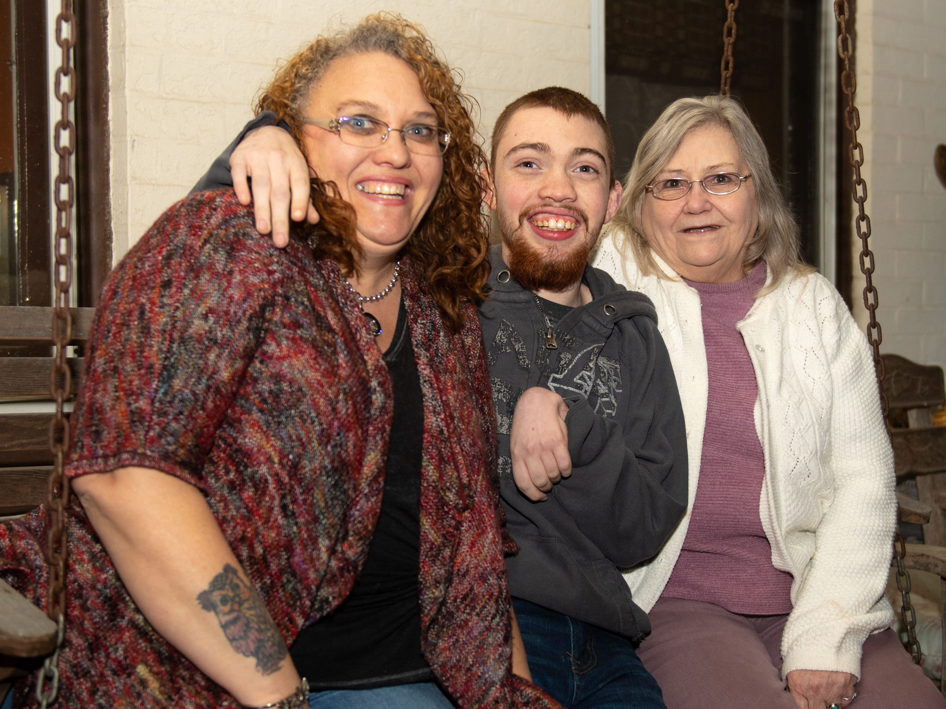 Hunter Leisenring (middle) is joined on his front porch by his mother, Yvette Wertz (left) and his grandmother, Sonya Cottle (right), January 8, 2019.