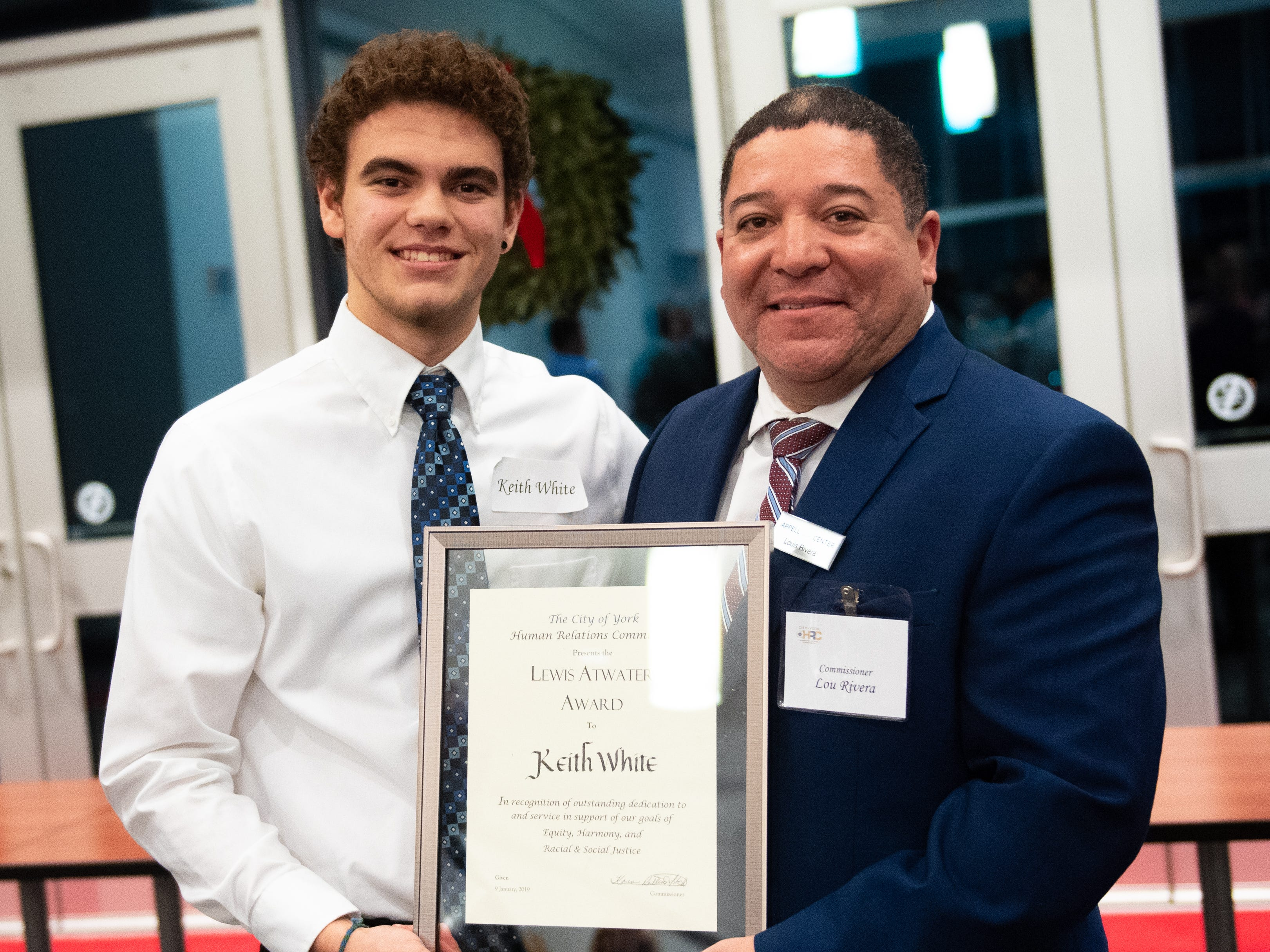 Lewis Atwater Award winner Keith White (left) and Commissioner Luis Rivera (right) can't hide their smiles as they hold the award during the 2019 City of York Human Relations Commission Diversity Dinner at York College, January 9, 2019.