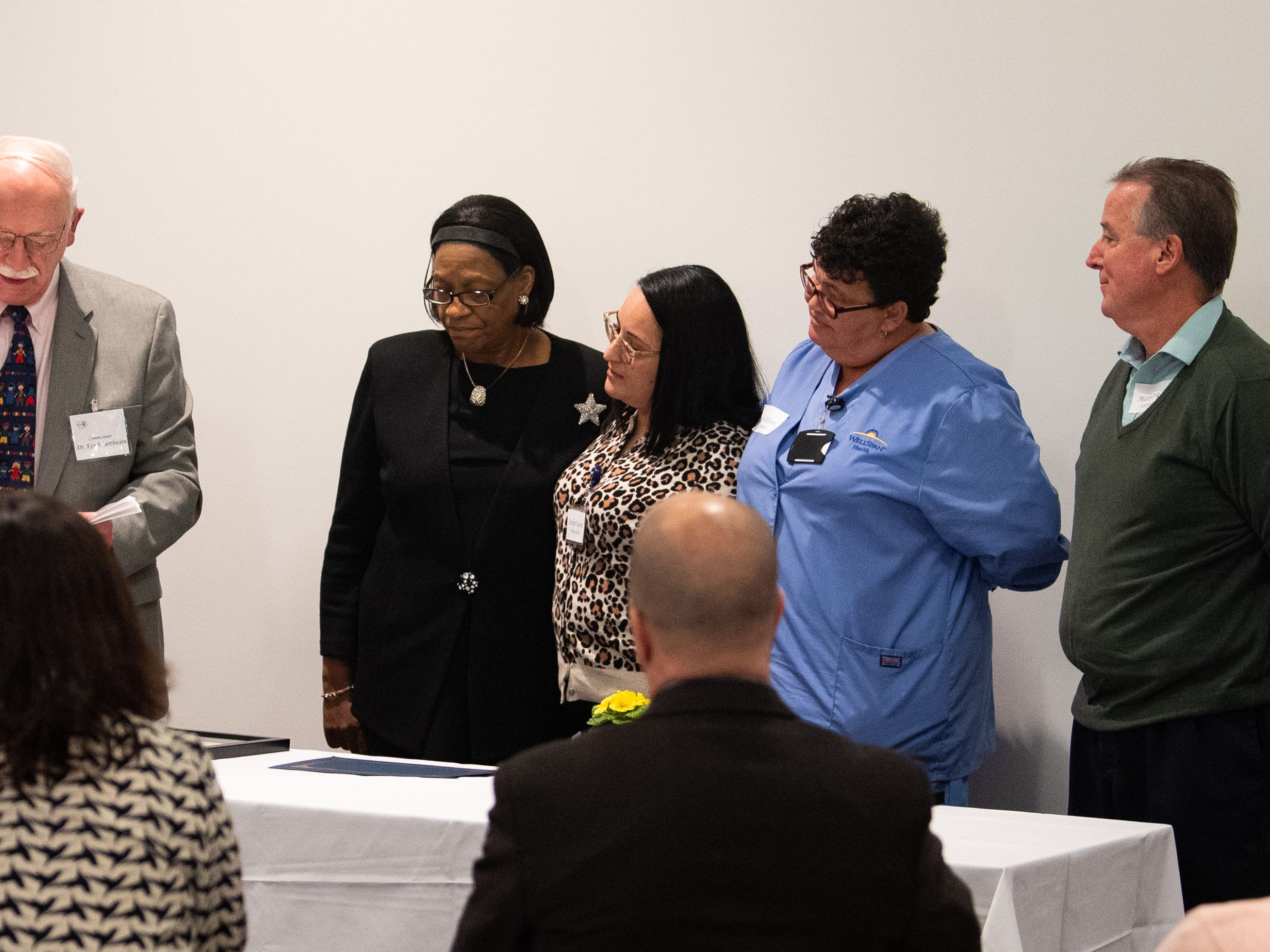 Dr. Kenneth Woerthwein (left) presents the Small Business Award Of The Year to the WellSpan Family Medicine of Bannister Street during the 2019 City of York Human Relations Commission Diversity Dinner at York College, January 9, 2019.