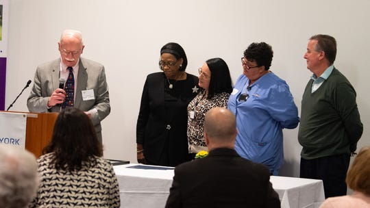 Dr. Kenneth Woerthwein, left, presents the Small Business of the Year award to WellSpan Family Medicine of Bannister Street during the 2019 City of York Human Relations Commission Diversity Dinner.