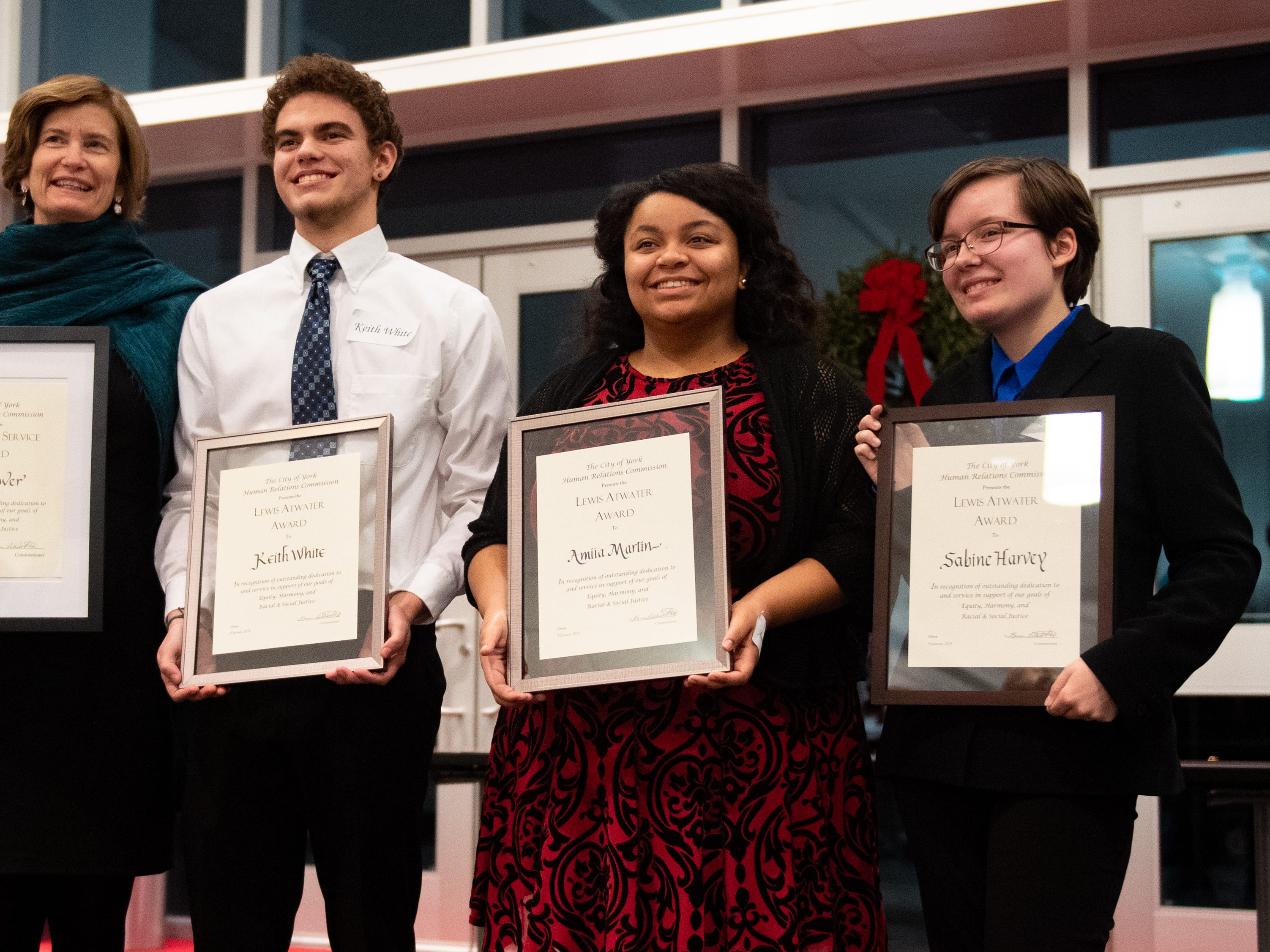 (Left to right) Jane Conover, Keith White, Amiia Martin and Sabine Harvey proudly show off their awards during the 2019 City of York Human Relations Commission Diversity Dinner at York College, January 9, 2019.