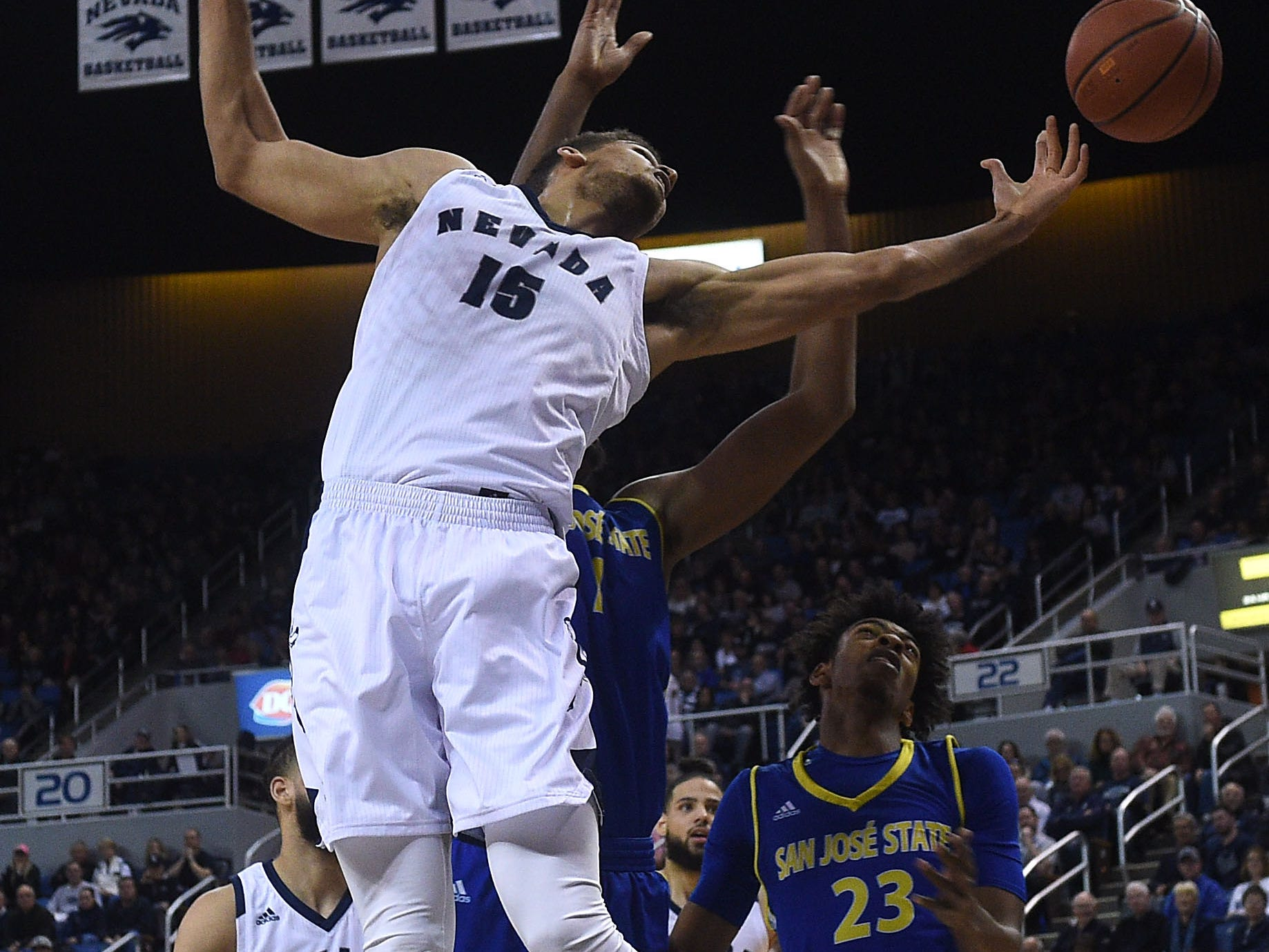 Nevada's Trey Porter tries to grab a rebound while taking on San Jose State during their basketball game at Lawlor Events Center in Reno on Jan. 9, 2019.