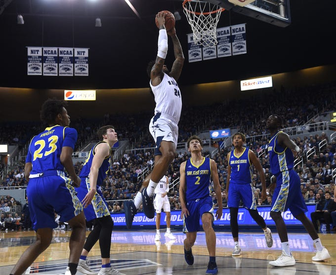Nevada's Jordan Caroline dunks while taking on San Jose State during their basketball game at Lawlor Events Center in Reno on Jan. 9, 2019.