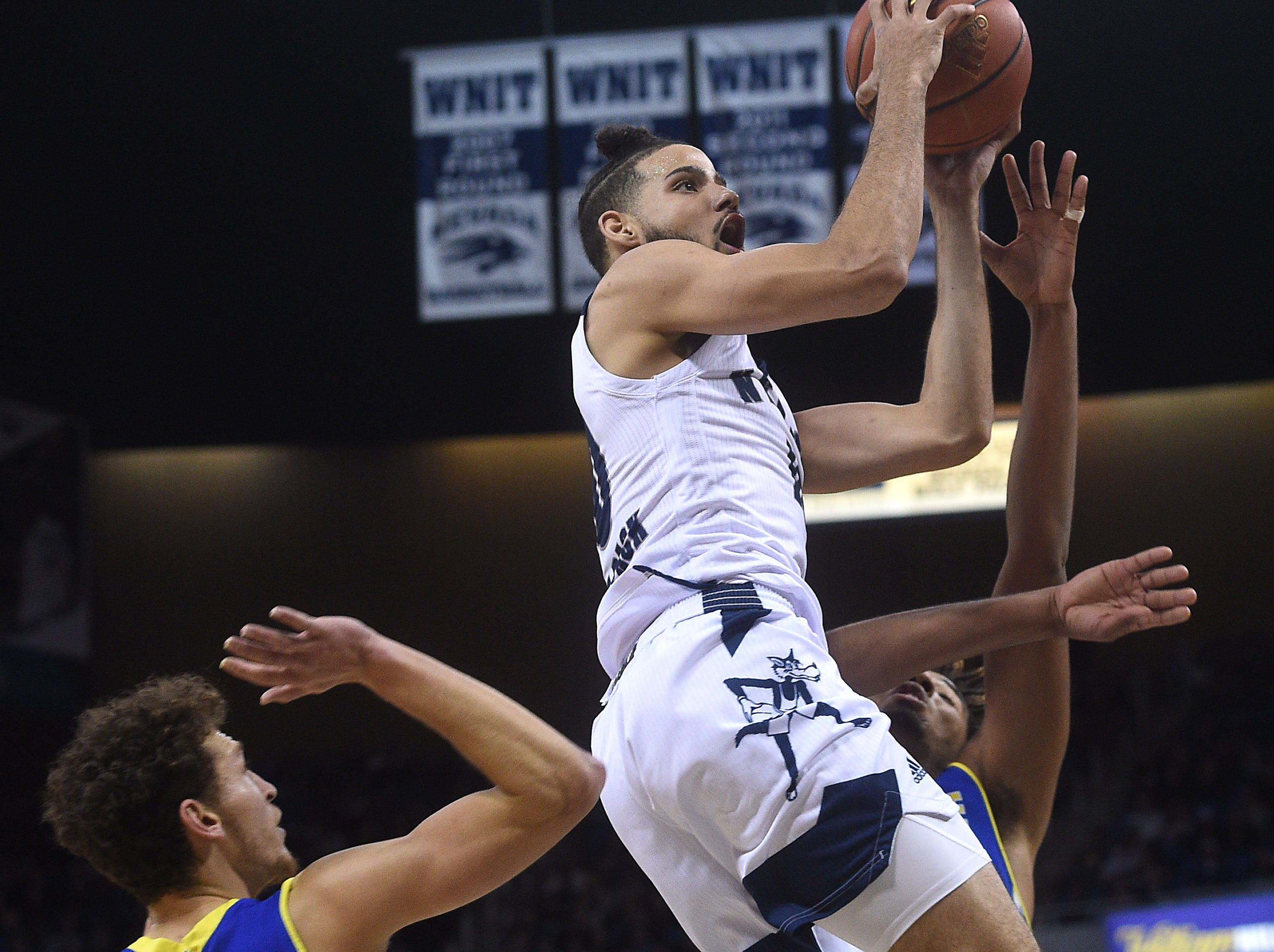 Nevada's Caleb Martin drives to the basket while taking on San Jose State during their basketball game at Lawlor Events Center in Reno on Jan. 9, 2019.