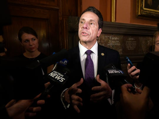 New York Gov. Andrew Cuomo speaks to reporters on the opening day of the legislative session at the Capitol, Wednesday, Jan. 9, 2019, in Albany, N.Y.