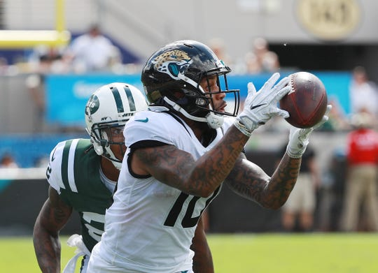 Donte Moncrief  of the Jacksonville Jaguars reaches for the football on the way to a second half touchdown during a game against the New York Jets on Sept. 30, 2018 in Jacksonville, Fla.