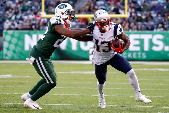 New England's Phillip Dorsett is tackled by Trumaine Johnson of the New York Jets during the fourth quarter of a game at MetLife Stadium on Nov. 25, 2018 in East Rutherford, New Jersey.