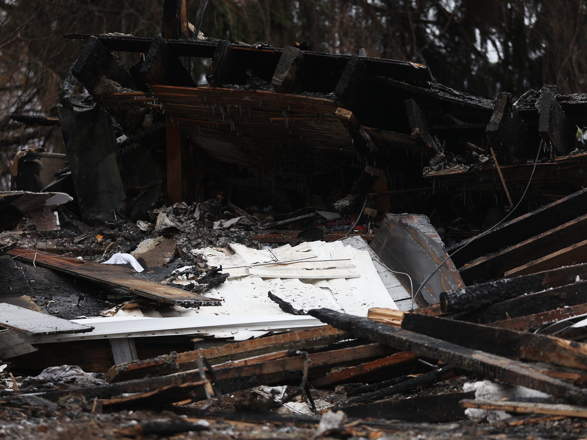 The two-story farmhouse collapsed in on itself during the fire.