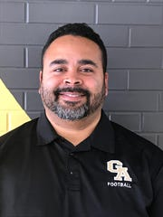 Mike Husdan takes over as the Greece Athena varsity football coach in 2019.