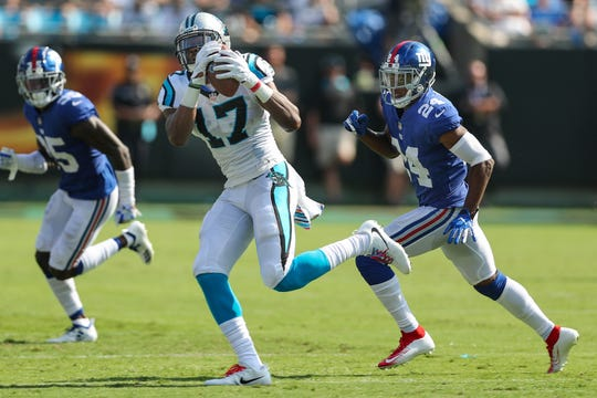 Carolina Panthers wide receiver Devin Funchess (17) makes a catch as former New York Giants cornerback Eli Apple (24) defends during a game last season.