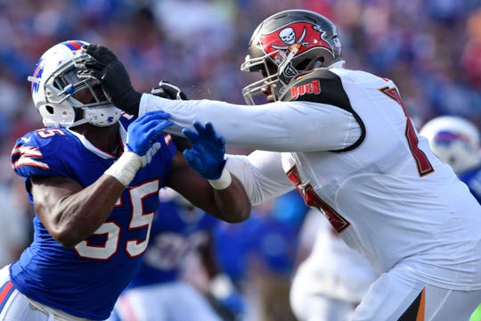 Tampa Bay  offensive tackle Donovan Smith (76) puts his hands to the face of Buffalo Bills defensive end Jerry Hughes (55) during the third quarter of a 2017 game at New Era Field. Smith, who is a free agent this off-season, is a former second-round pick.