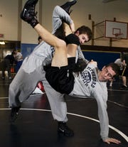 Kyle Borshoff, who attended Pittsford Mendon, takes down his brother and teammate Jasen Borshoff during a Pittsford Panthers practice back in 2004.