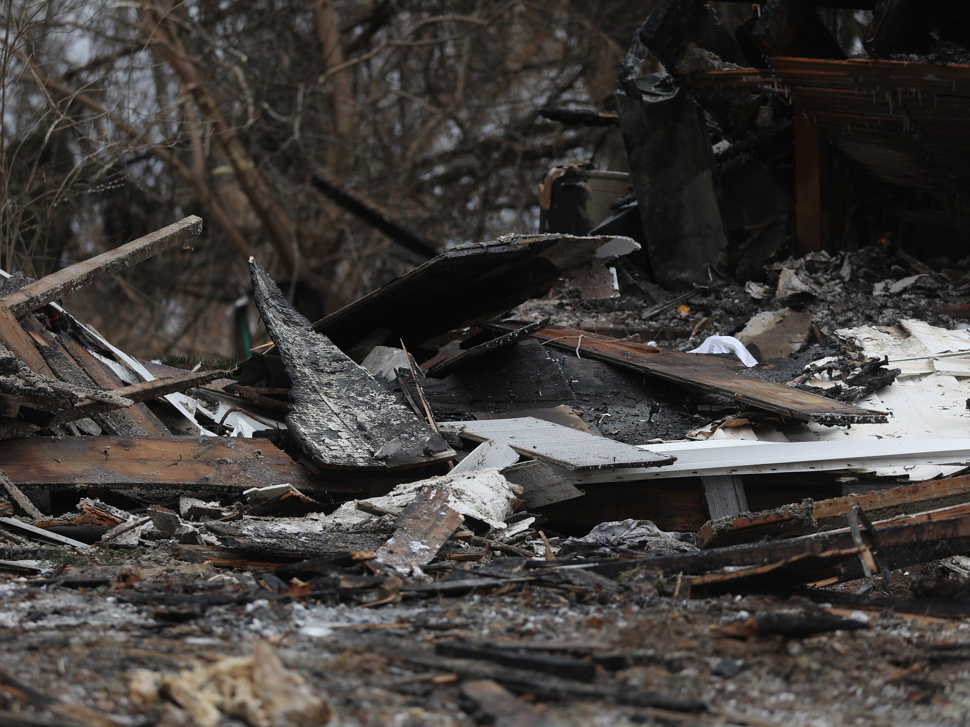 """Fire Chief Peter Smith of the Hamlin Morton Walker Fire District called it a """"wind-driven fire.""""  He said winds were probably around 50 mph during the time of the fire. The house is near open fields."""