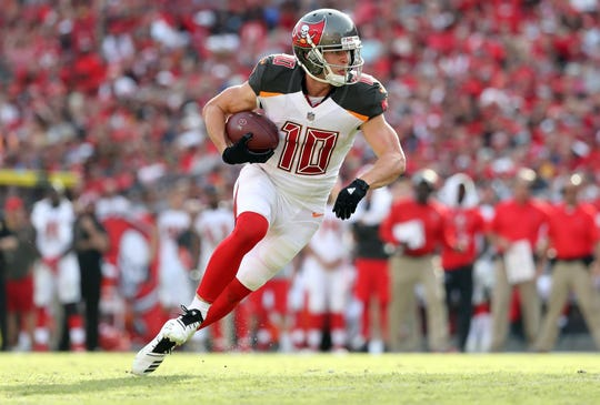 Tampa Bay Buccaneers wide receiver Adam Humphries (10) runs the ball in for a touchdown  against the San Francisco 49ers.