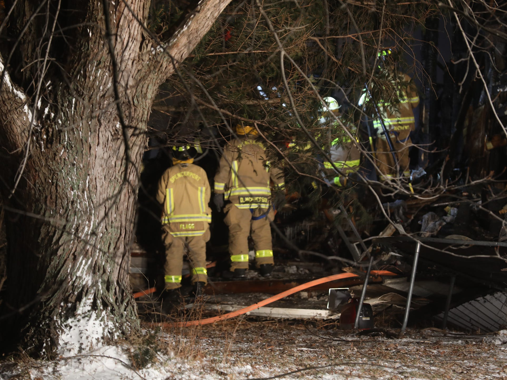 The back of the house was engulfed in flames; it was also the area the residents used to enter and exit the home.