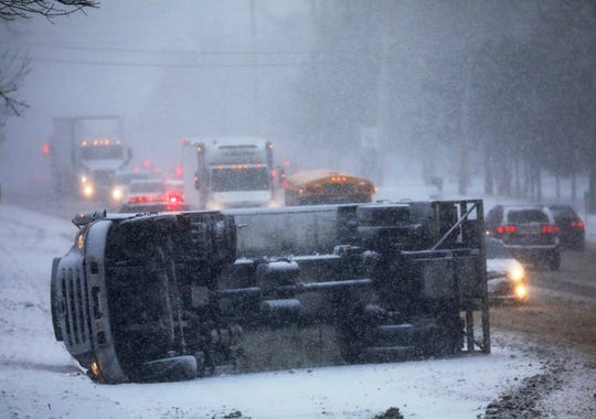 A truck landed on its side on Route 31 in Fairport Thursday morning.