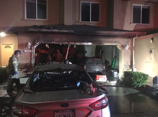 Redding firefighters were aided by a fire sprinkler in putting out a garage fire early Thursday morning on Sinaloa Trail.
