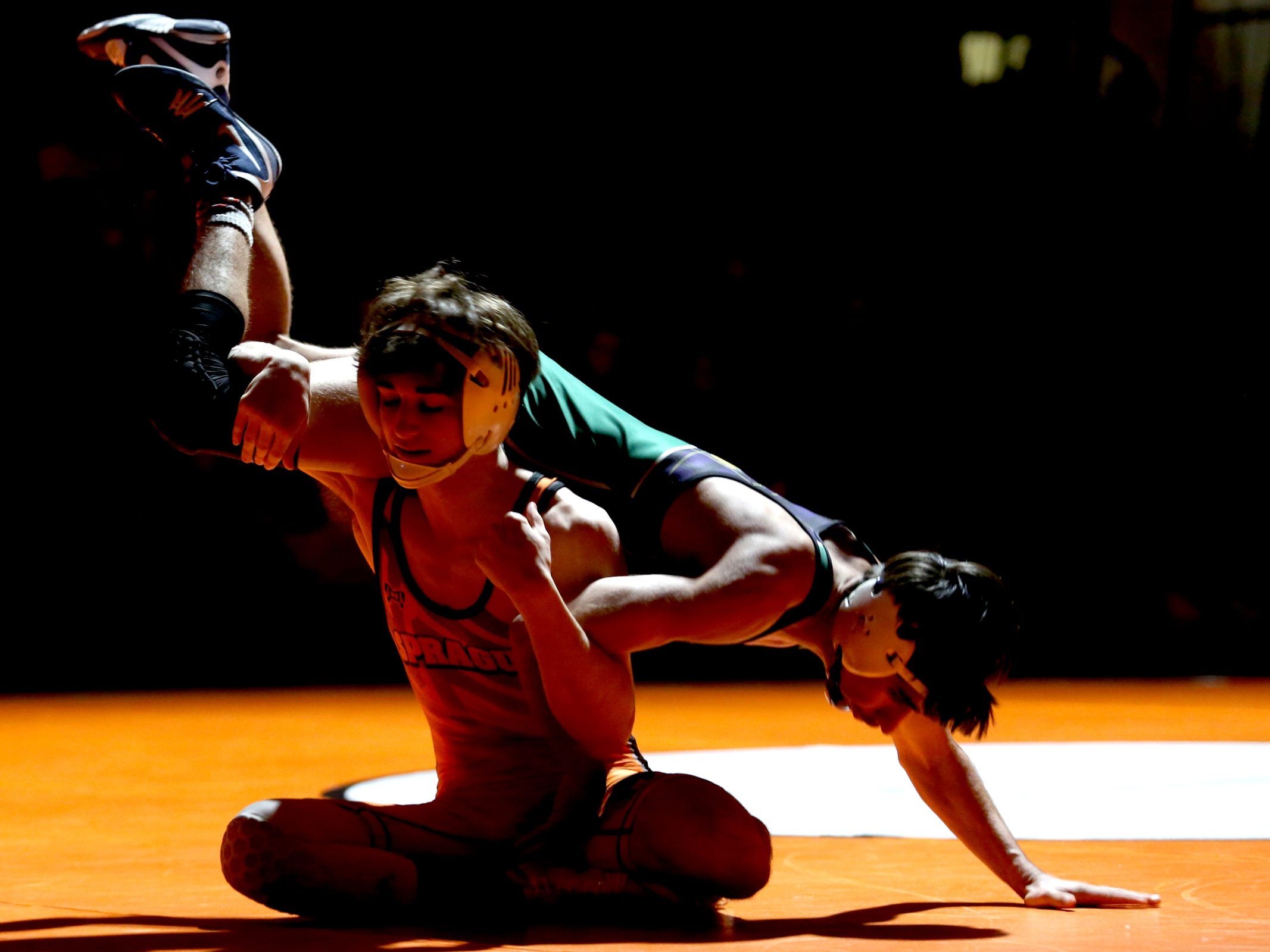 Sprague's Noah Worthington, left, and McKay's Bryant Mendoza compete in the 120 pound weight class during the McKay vs. Sprague wrestling meet at Sprague High School in Salem on Wednesday, Jan. 9, 2019.