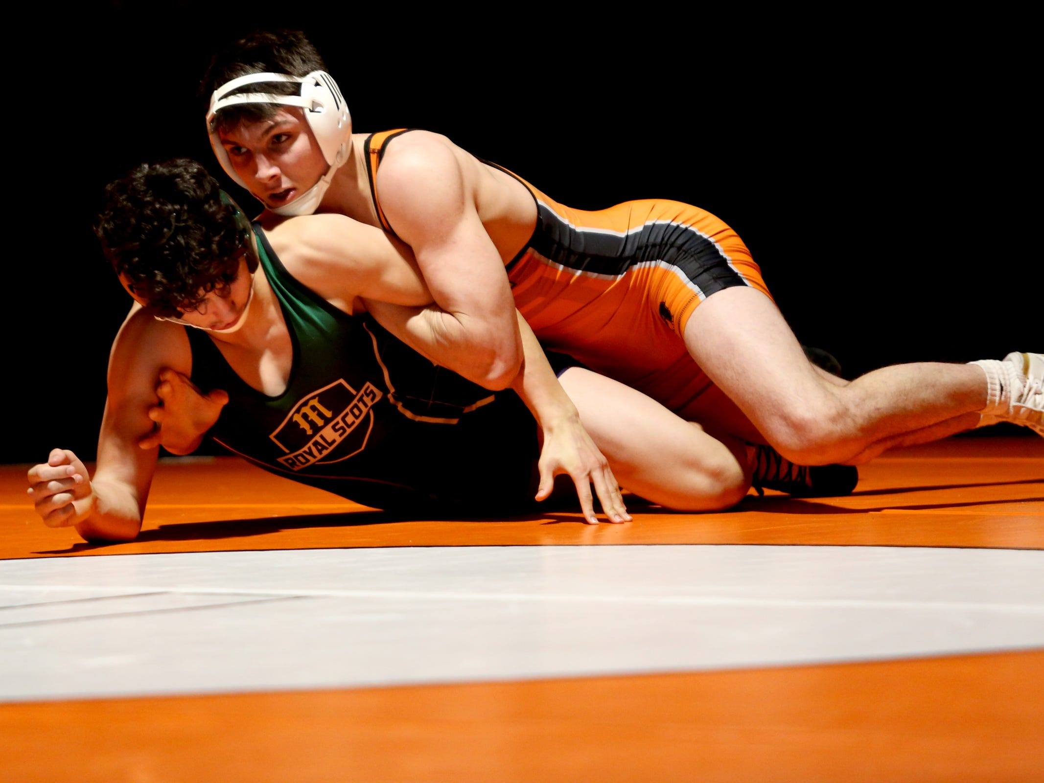 Sprague's Brook Byers, top, and McKay's Gavin Harris compete in the 152 pound weight class during the McKay vs. Sprague wrestling meet at Sprague High School in Salem on Wednesday, Jan. 9, 2019.