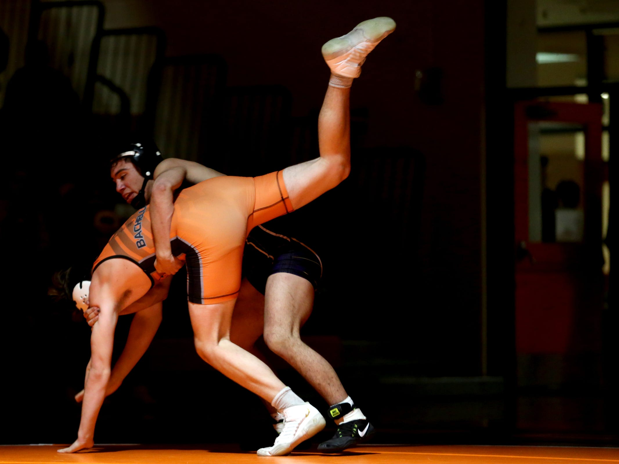 McKay's David Rubio, top, and Sprague's Cole Bacheller compete in the 170 pound weight class during the McKay vs. Sprague wrestling meet at Sprague High School in Salem on Wednesday, Jan. 9, 2019.