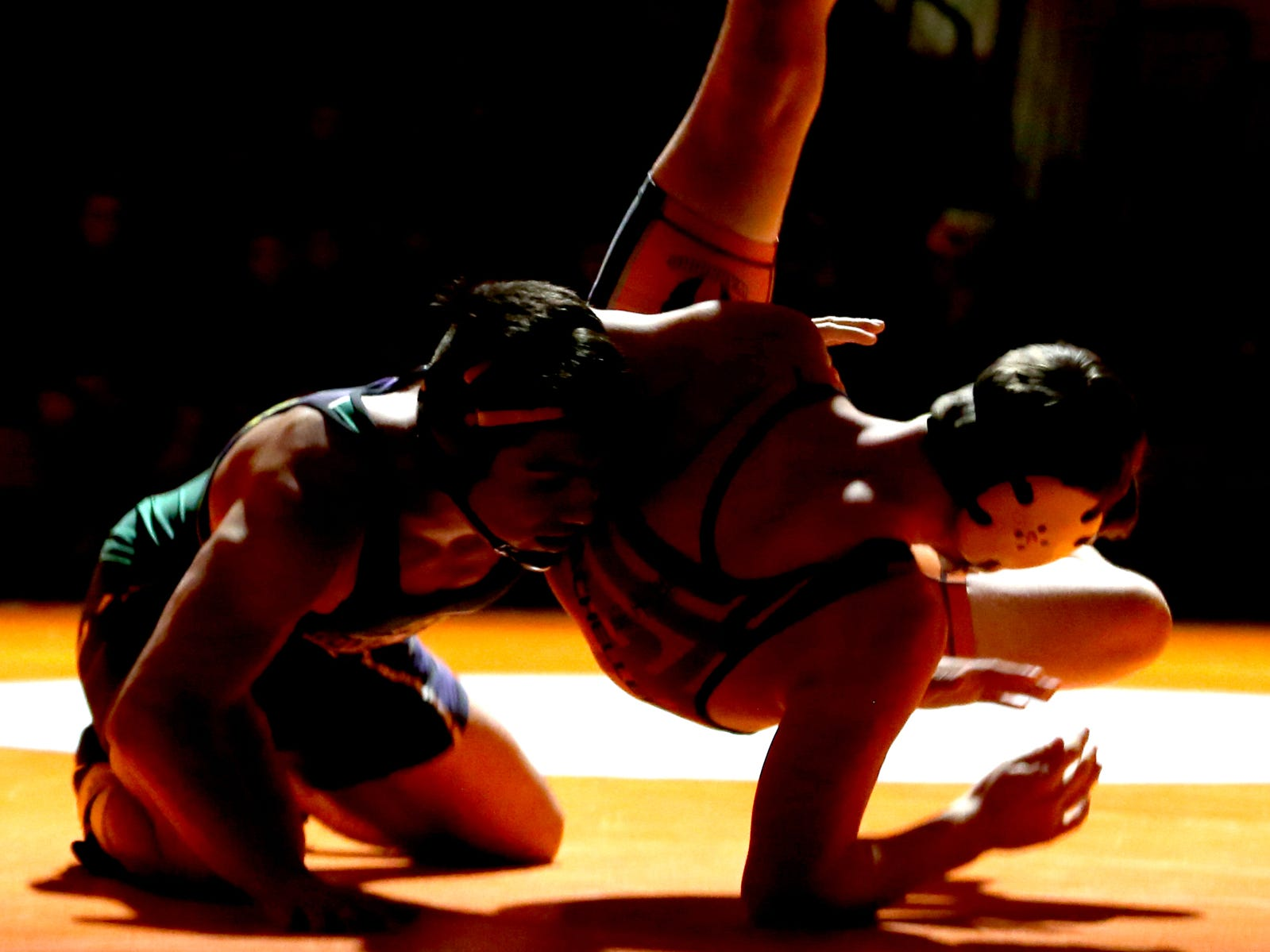 McKay's David Rubio, left, and Sprague's Cole Bacheller compete in the 170 pound weight class during the McKay vs. Sprague wrestling meet at Sprague High School in Salem on Wednesday, Jan. 9, 2019.