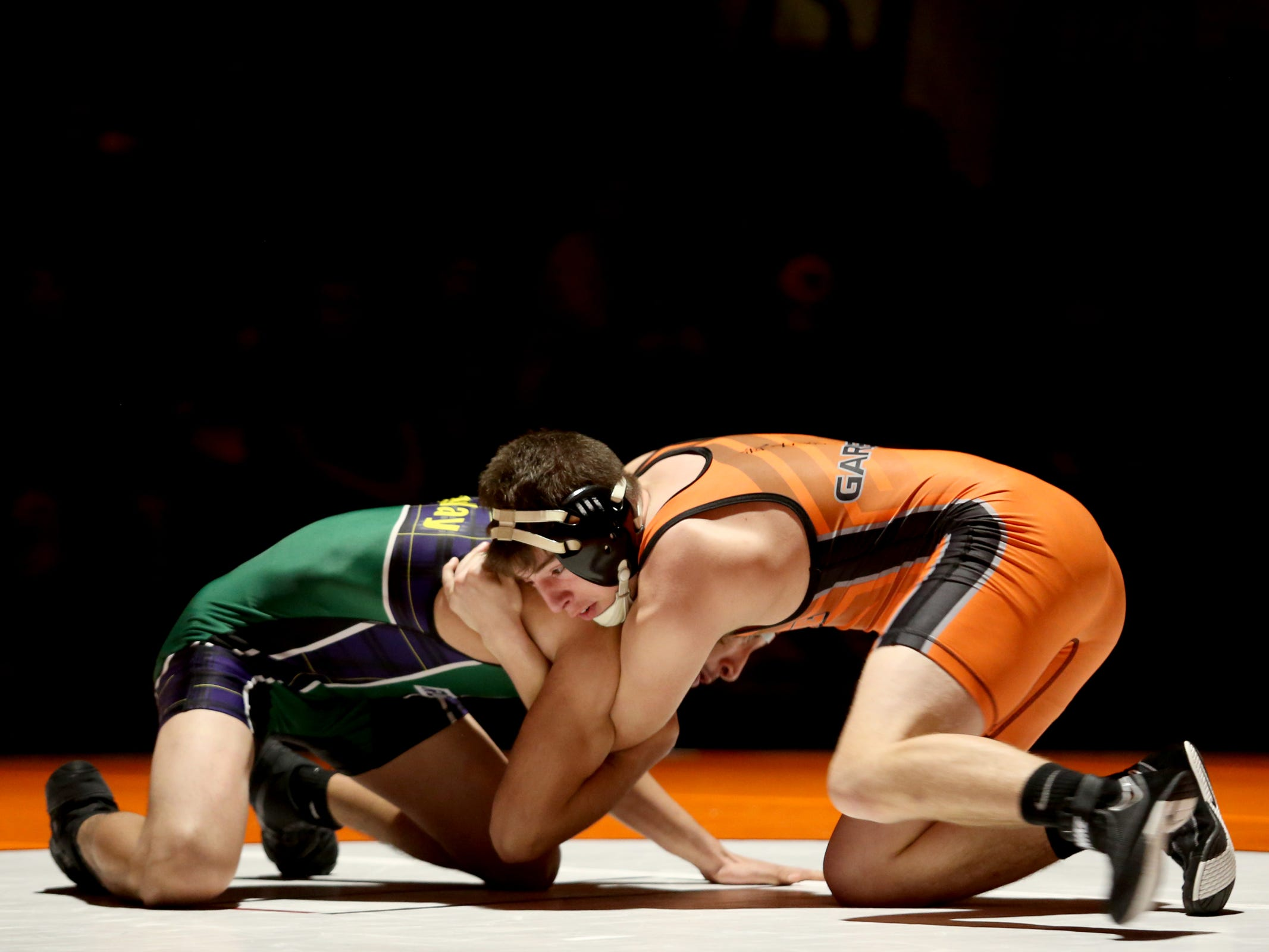 Sprague's Maximus Garrett, front, and McKay's Enrique Montoya compete in the 132 pound weight class during the McKay vs. Sprague wrestling meet at Sprague High School in Salem on Wednesday, Jan. 9, 2019.