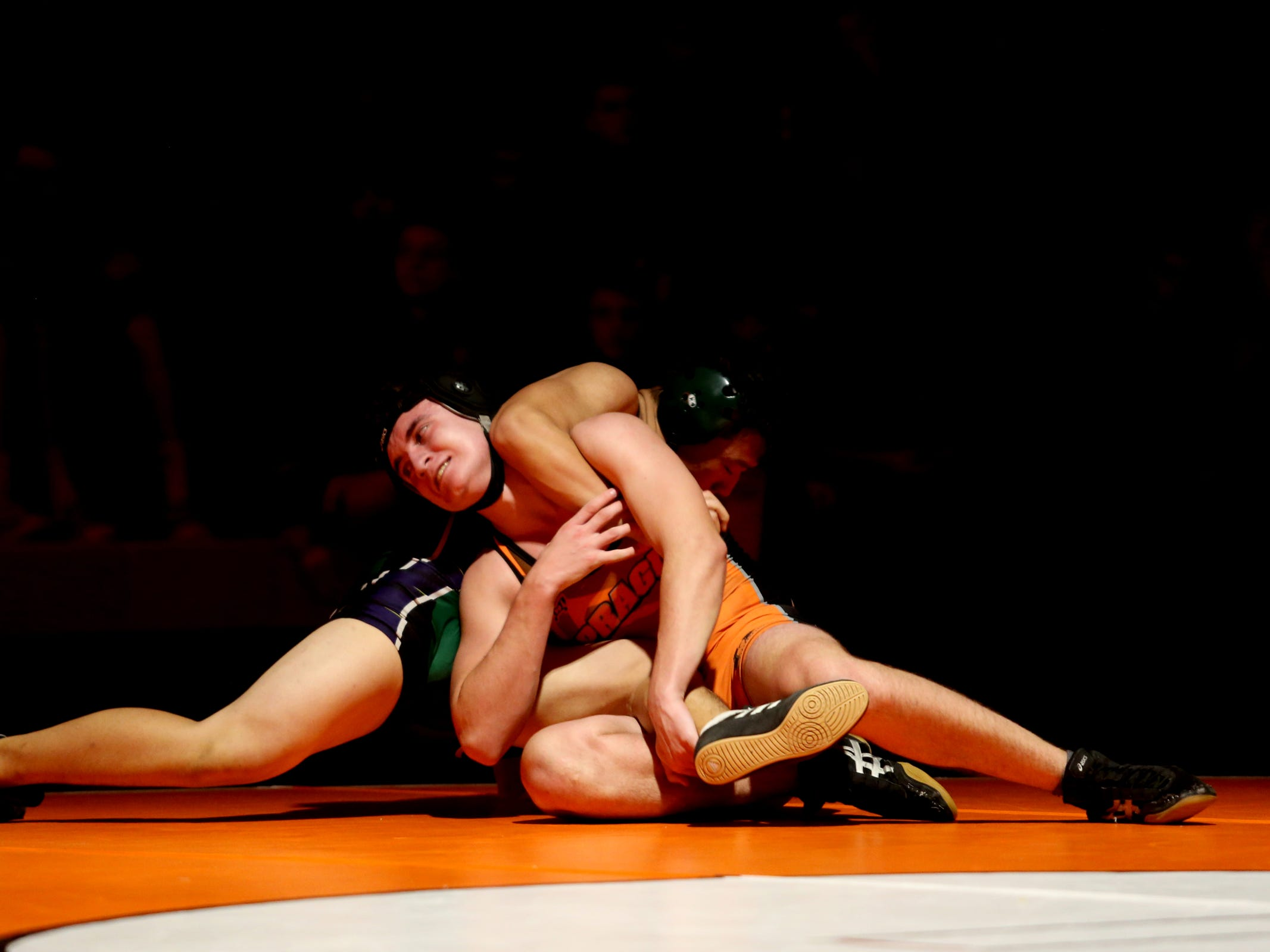 Sprague's Stan Cernev, left, and McKay's Andy Nguyen compete in the 182 pound weight class during the McKay vs. Sprague wrestling meet at Sprague High School in Salem on Wednesday, Jan. 9, 2019.
