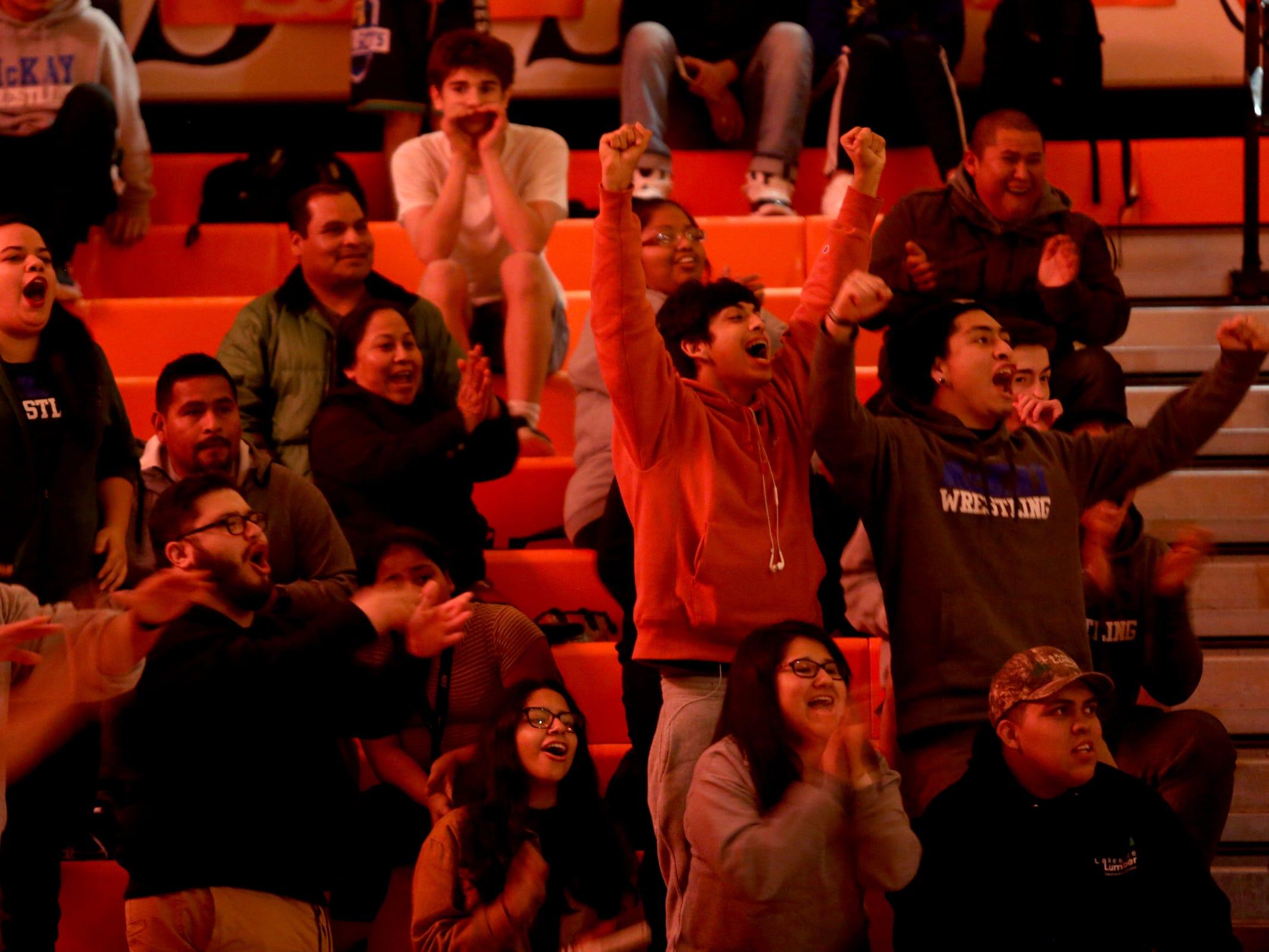McKay fans cheer during the McKay vs. Sprague wrestling meet at Sprague High School in Salem on Wednesday, Jan. 9, 2019.
