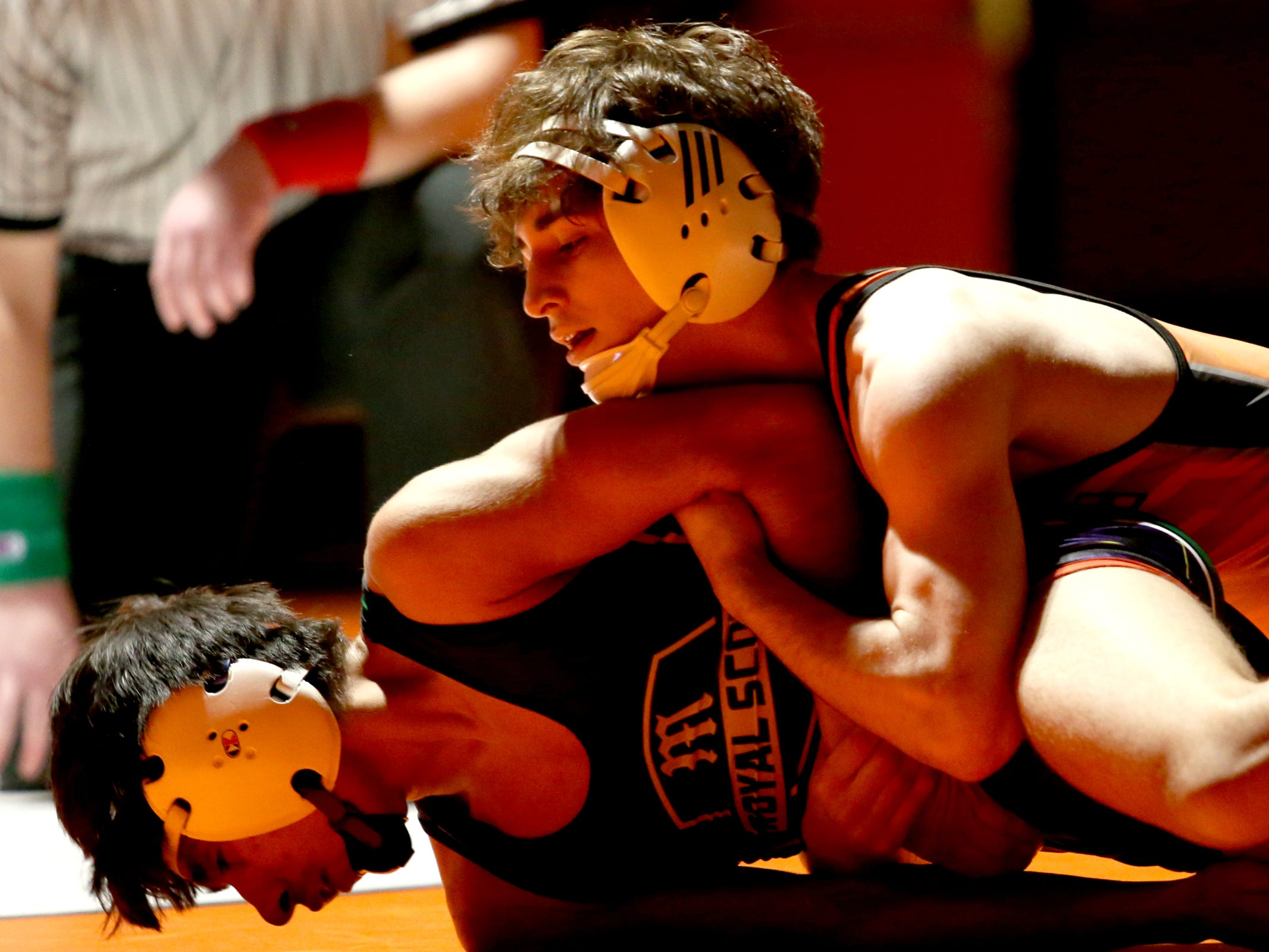 Sprague's Noah Worthington, top, and McKay's Bryant Mendoza compete in the 120 pound weight class during the McKay vs. Sprague wrestling meet at Sprague High School in Salem on Wednesday, Jan. 9, 2019.