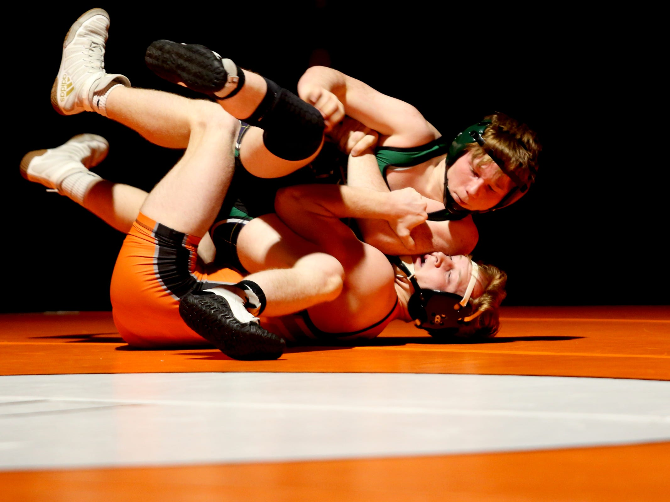 McKay's Patrick Neevel, top, and Sprague's Colby Hemmert compete in the 126 pound weight class during the McKay vs. Sprague wrestling meet at Sprague High School in Salem on Wednesday, Jan. 9, 2019.
