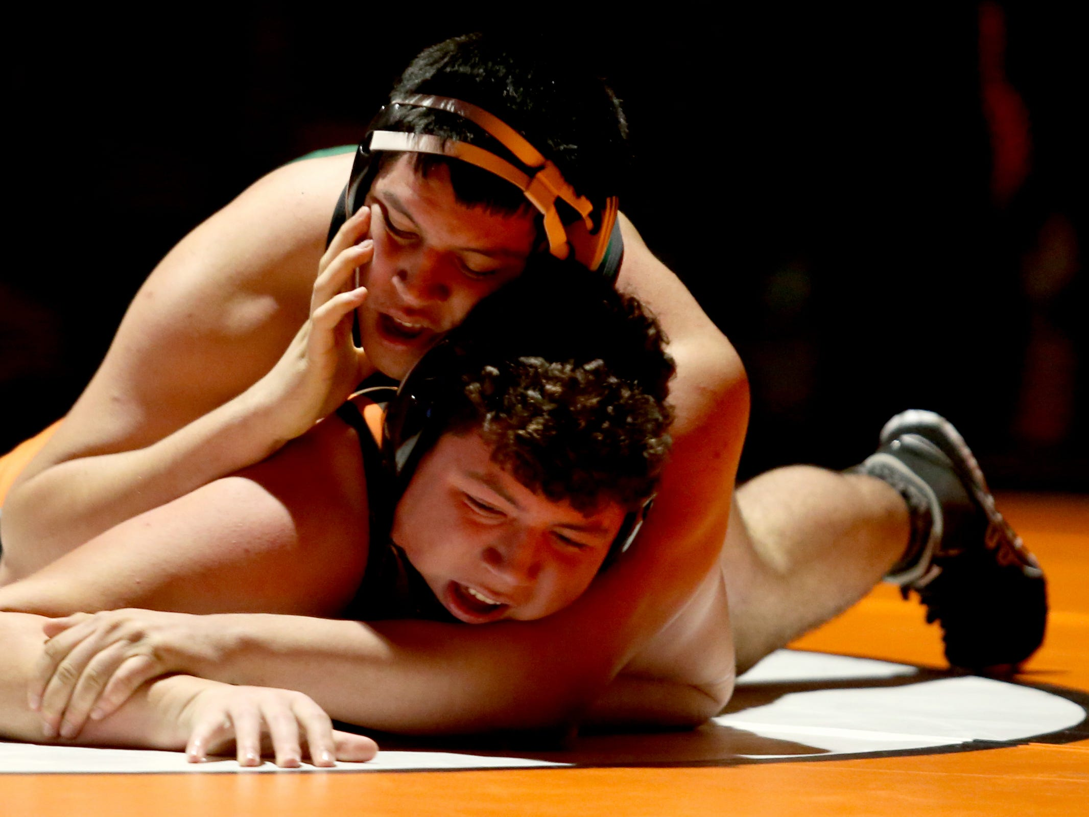 McKay's Israel Rivas, top, and Sprague's David Sherman compete in the 220 pound weight class during the McKay vs. Sprague wrestling meet at Sprague High School in Salem on Wednesday, Jan. 9, 2019.