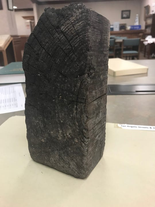 San Angelo's first foray into paving streets involved creosoted pine blocks like this one, packed tightly between wooden beams. This original paving block is part of the West Texas Collection at Angelo State University.