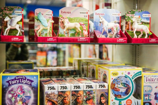 Games and toys are lined up on shelves Thursday, Jan. 10, 2019, at Specialties Games Toys & Gifts.
