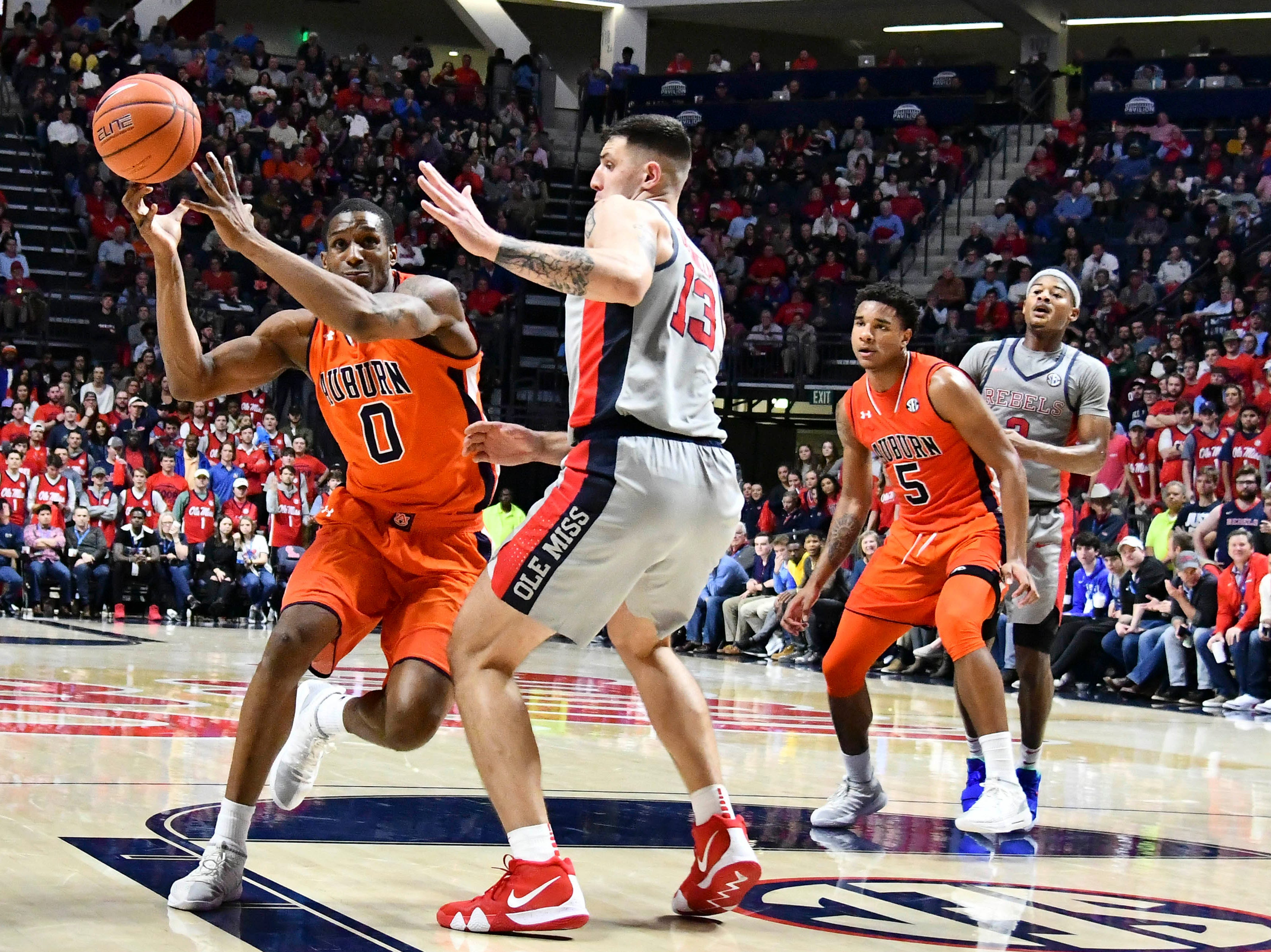 Jan 9, 2019; Oxford, MS, USA; Auburn Tigers forward Horace Spencer (0) loses possession of the ball while guarded by Mississippi Rebels center Dominik Olejniczak (13) during the second half at The Pavilion at Ole Miss. Mandatory Credit: Matt Bush-USA TODAY Sports