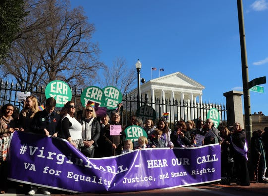 Supporters of the Equal Rights Amendment gather to greet legislators Wednesday, Jan. 9, outside the Capitol in Richmond, Virginia..