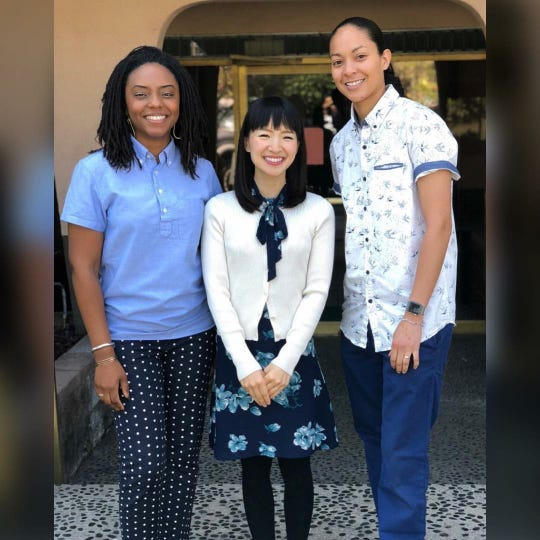 "Alishia Holmes-Watson (left), Marie Kondo (center) and Angela Holmes-Watson (right) pose for a photo. The couple are featured on an episode of Netflix's ""Tidying Up With Marie Kondo."" Courtesy of Angela Holmes-Watson."