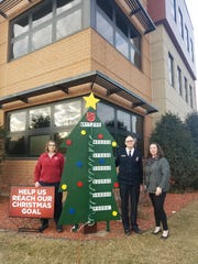 Captain Cherie Mangeri, Captain Daryl Mangeri, and Carrye Jo Cony with the goals of the Salvation Army's Christmas fundraising goals on Thursday, Jan. 10.