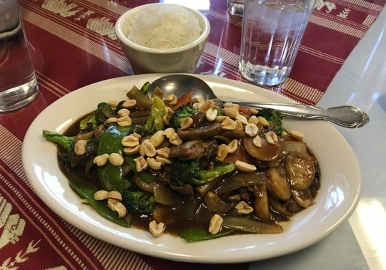 Kung Pao  Beef,  Stir-fried, cabbage, broccoli, onions, water chestnuts, pea pods, mushrooms and peanuts sprinkled on top. $7.95  I had Kung Pao which had the taste sensations I seek in a stir-fry dish.   I ordered mine with beef, which seemed of good lean quality. You can order this dish with beef, chicken, pork, tofu and for an extra charge shrimp.   My order was served on a an oval dish with a delightful flavor-filled dark sauce and a  side portion of white rice. The vegetables were perfectly done. They did not have the crunch taken out of them from the stir fry process. Perfectly cooked rice greeted me as it was not sticky or clumped together as I have seen at other area restaurants that offer white rice.