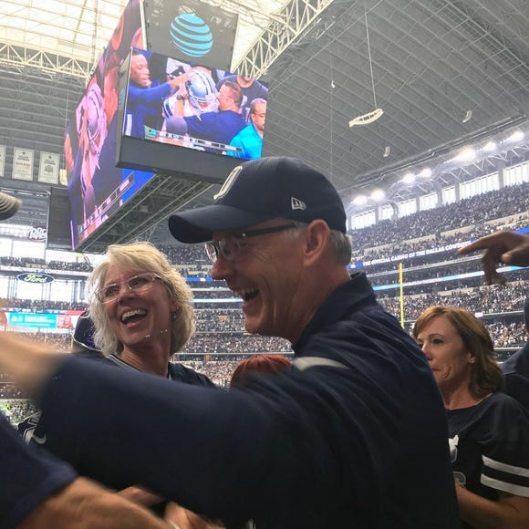 Sioux Falls Schools superintendent Brian Maher and his wife, Peggy, celebrate Brett Maher's game-winning field goal against the Detroit Lions.