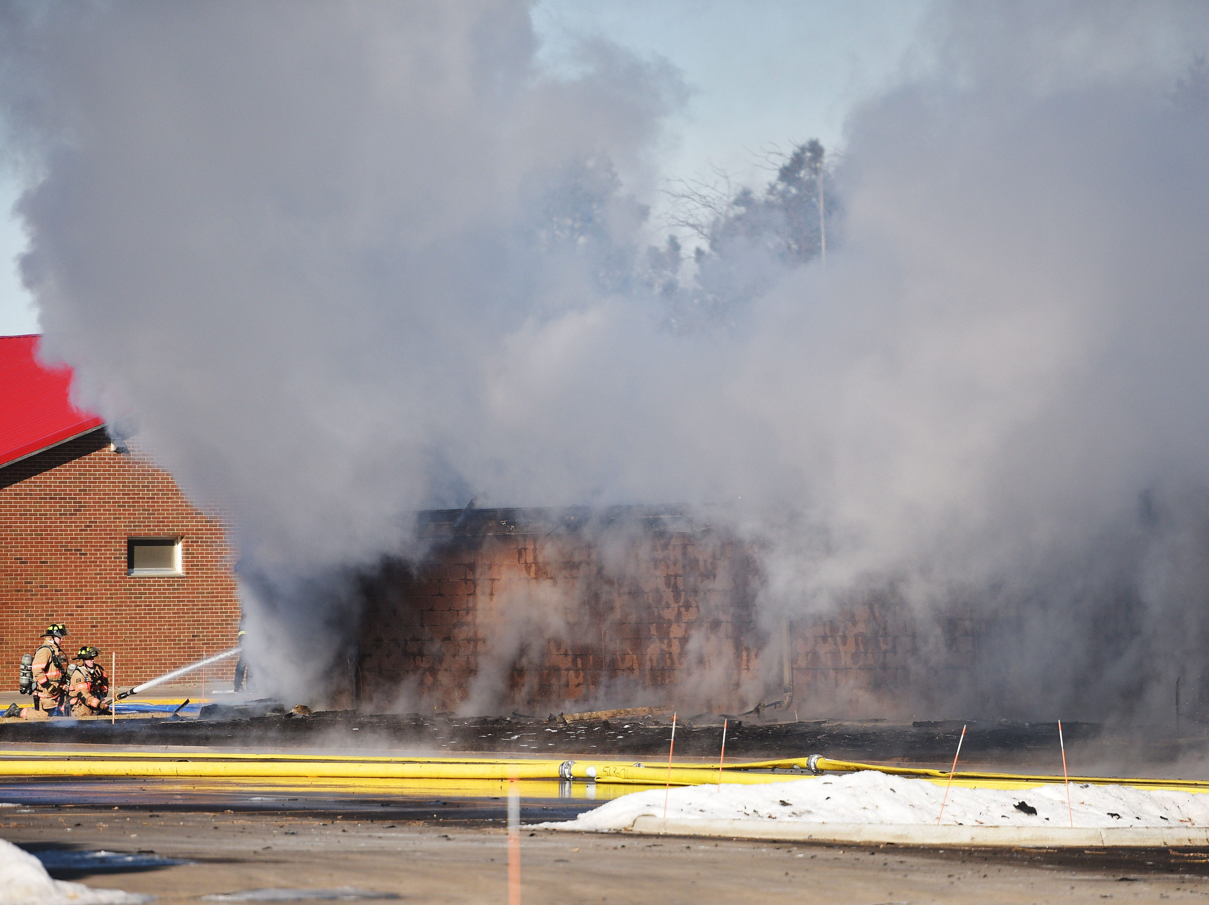 The golf cart shed at Elmwood Golf Cart is on fire Wednesday, Jan. 9, in western Sioux Falls.
