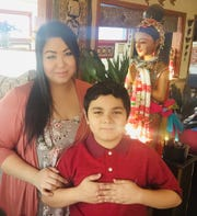 "Paneda ""Aneda"" Zelaya stands with her 10-year-old son, Anthony, at Thai Basil."