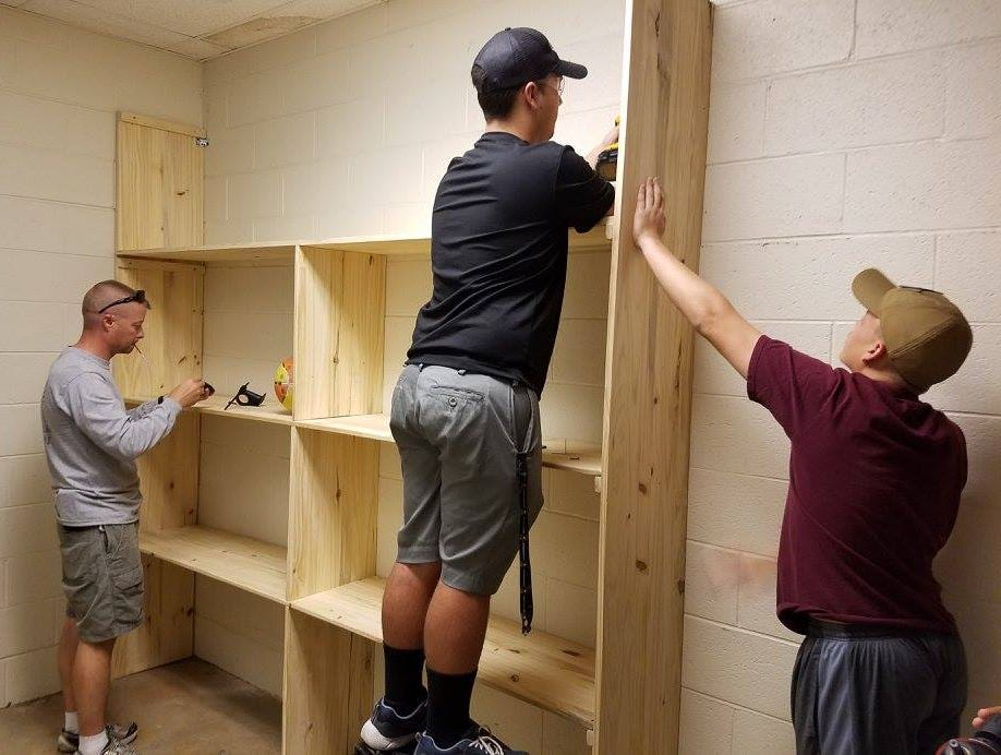 Jack Ford, who recently achieved the rank of Eagle Scout, build a physical education closet for his former teacher at Ozark East Elementary School.